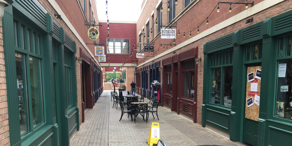 Acorn Alley in Kent, OH is a pedestrian walkway filled with shops and cafes, making productive use of a small space.