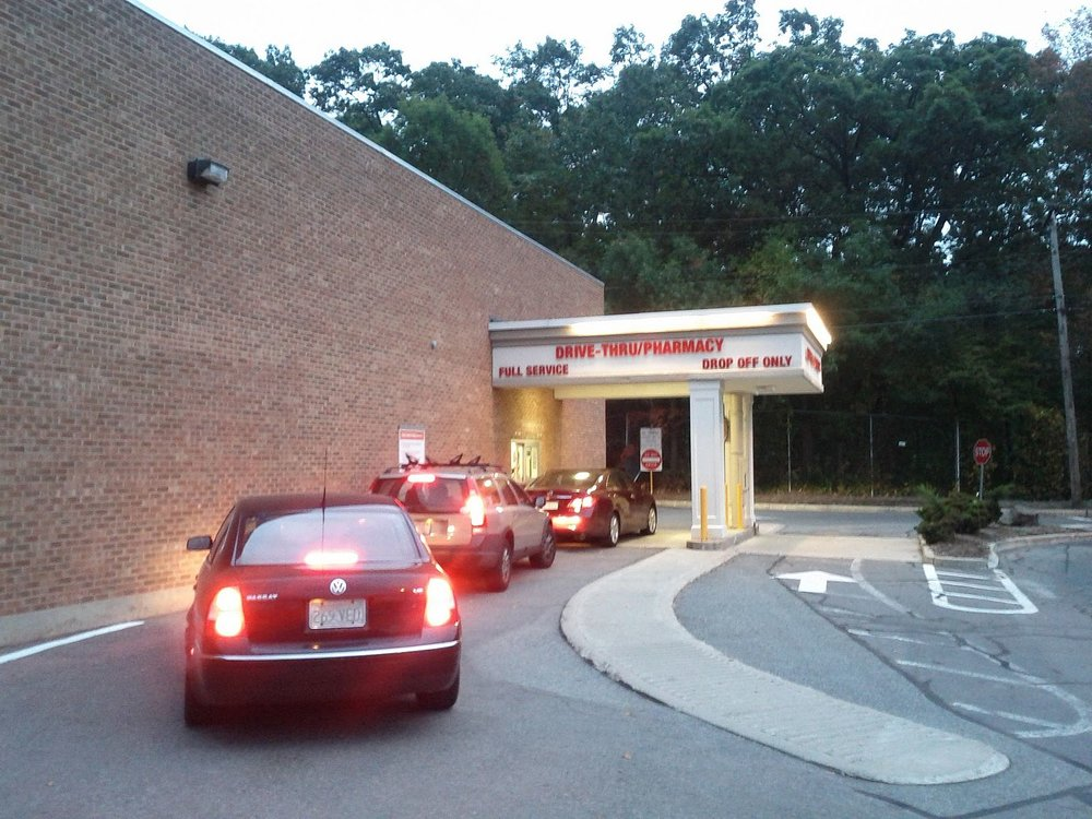 Drive-throughs are terrible for walkability, but chain retailers like Walgreens and CVS often insist on them, because they know their customers drive. (Photo: Wikimedia Commons)