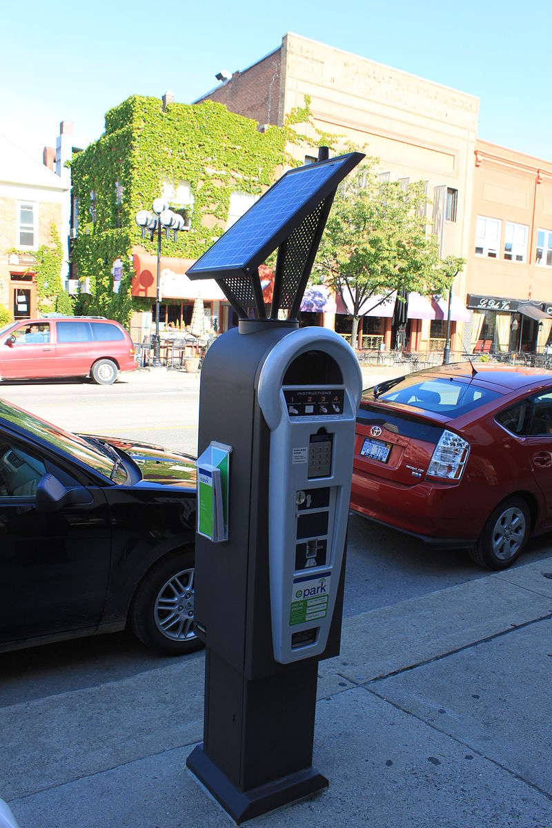 Modern parking pay stations can adjust the price dynamically to be higher at times of high demand, and lower at off hours. The revenue is best devoted to improvements in the neighborhood where meters are installed. (Source: Wikimedia Commons)