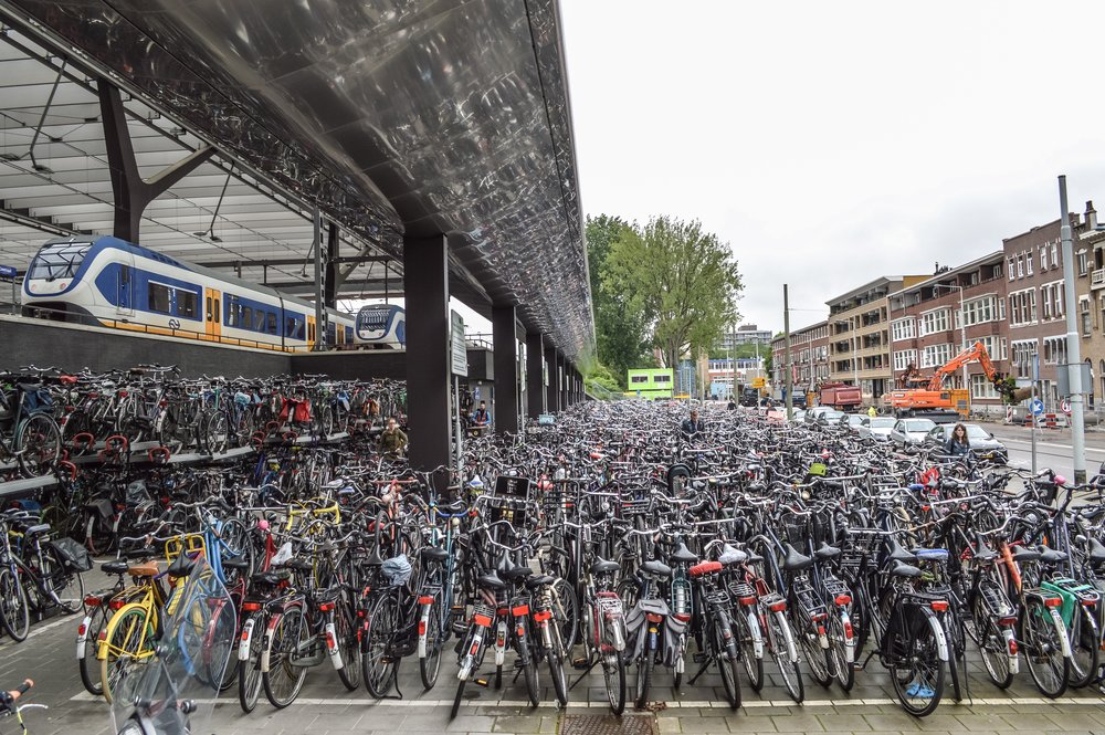 Bike parking at a train station in the Netherlands. (Photo courtesy of Chris and Melissa Bruntlett)