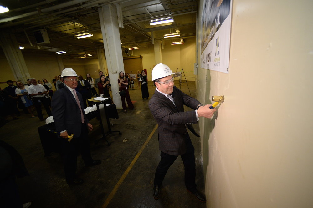 First floor wall-breaking ceremony with Doug Weintraub and Akron mayor Dan Horrigan