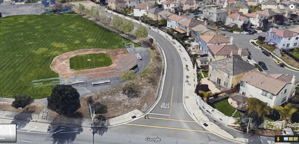 Left: Orchard School. Middle: Silk Wood Lane, the future east end of the overpass—the current plan calls for four lanes here. Right: Residential neighborhood, with a large mobile home park further right (outside of the frame). Almost 300 students live on this side of the school. (Click to view larger)