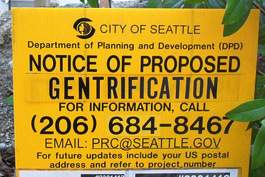 "A planning department notice labeled with ""Gentrification"" as a protest gesture. (Source:  Flickr  via Creative Commons license)"