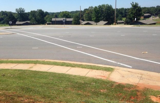 The 160-foot crossing on Oak Street in Forest City, North Carolina. You get nothing but paint, and the least effective crosswalk marking to boot!