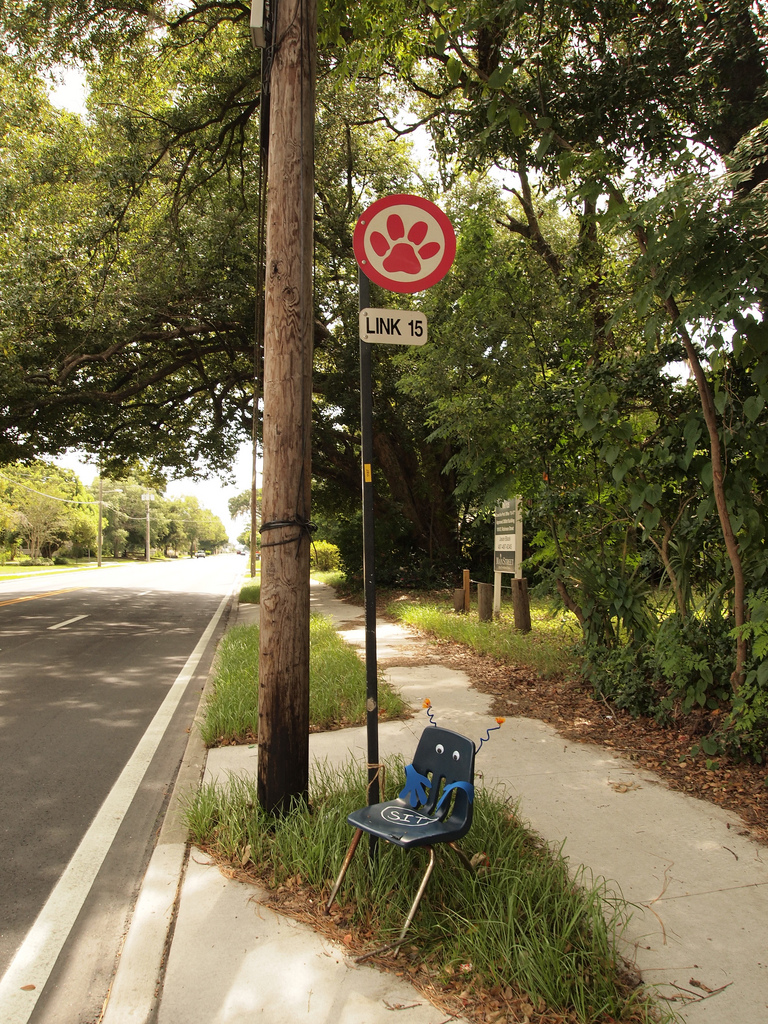 Bus stops like this one in Orlando are useless to many seniors, despite the efforts of an enterprising citizen in this case to redress the lack of seating. (Image via  Flickr )