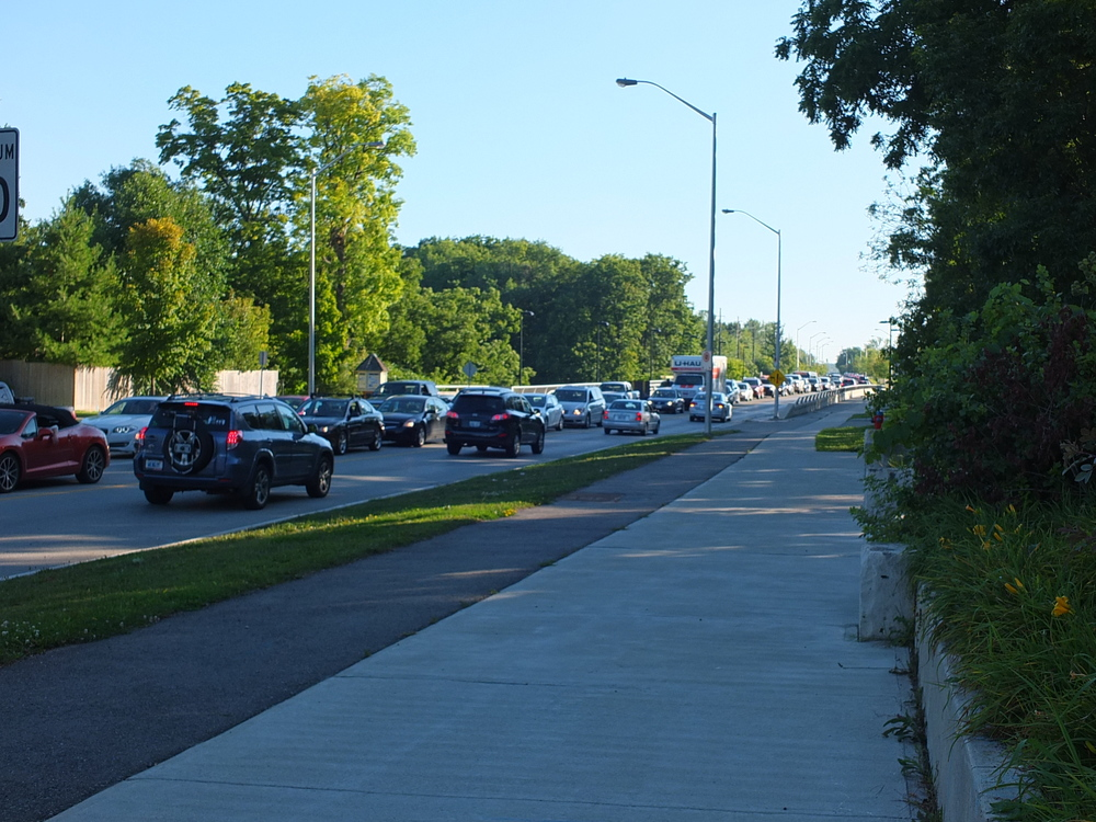 Rebecca Bridge at Bronte.  Cars lined up beyond Great Lakes Blvd