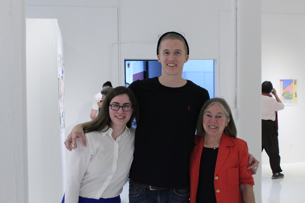Students Elizabeth Meyers and Colin Hewitt with program director Diana Gisolfi at the 2012 Exhibition opening.