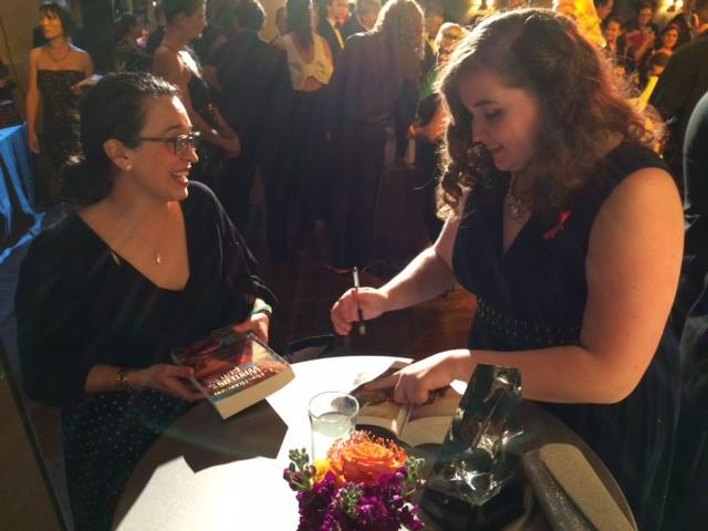 Megan Signing a copy of  L. Ron Hubbard Writers of the Future Volume 31