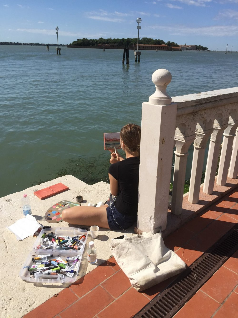Samantha Busiello painting by the canal.