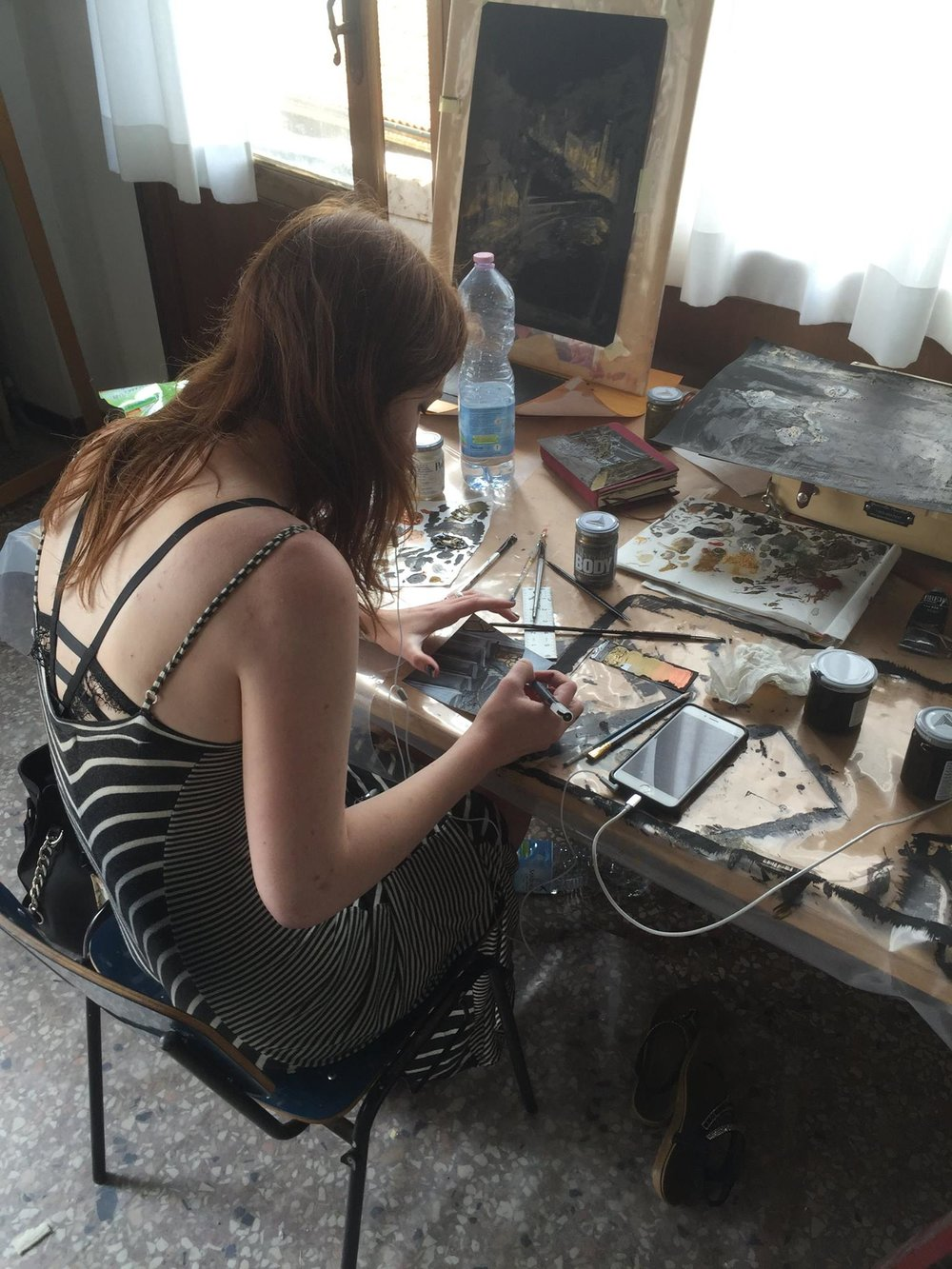 Illustration student Annabelle Tracy works in the studio.