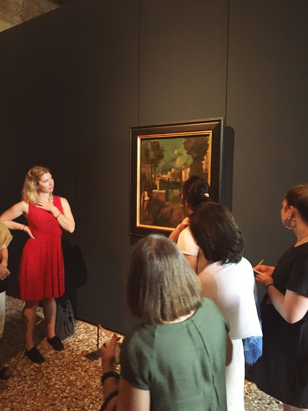 "Students discuss Giorgione's ""The Tempest"" at the Galleria dell'Accademia"