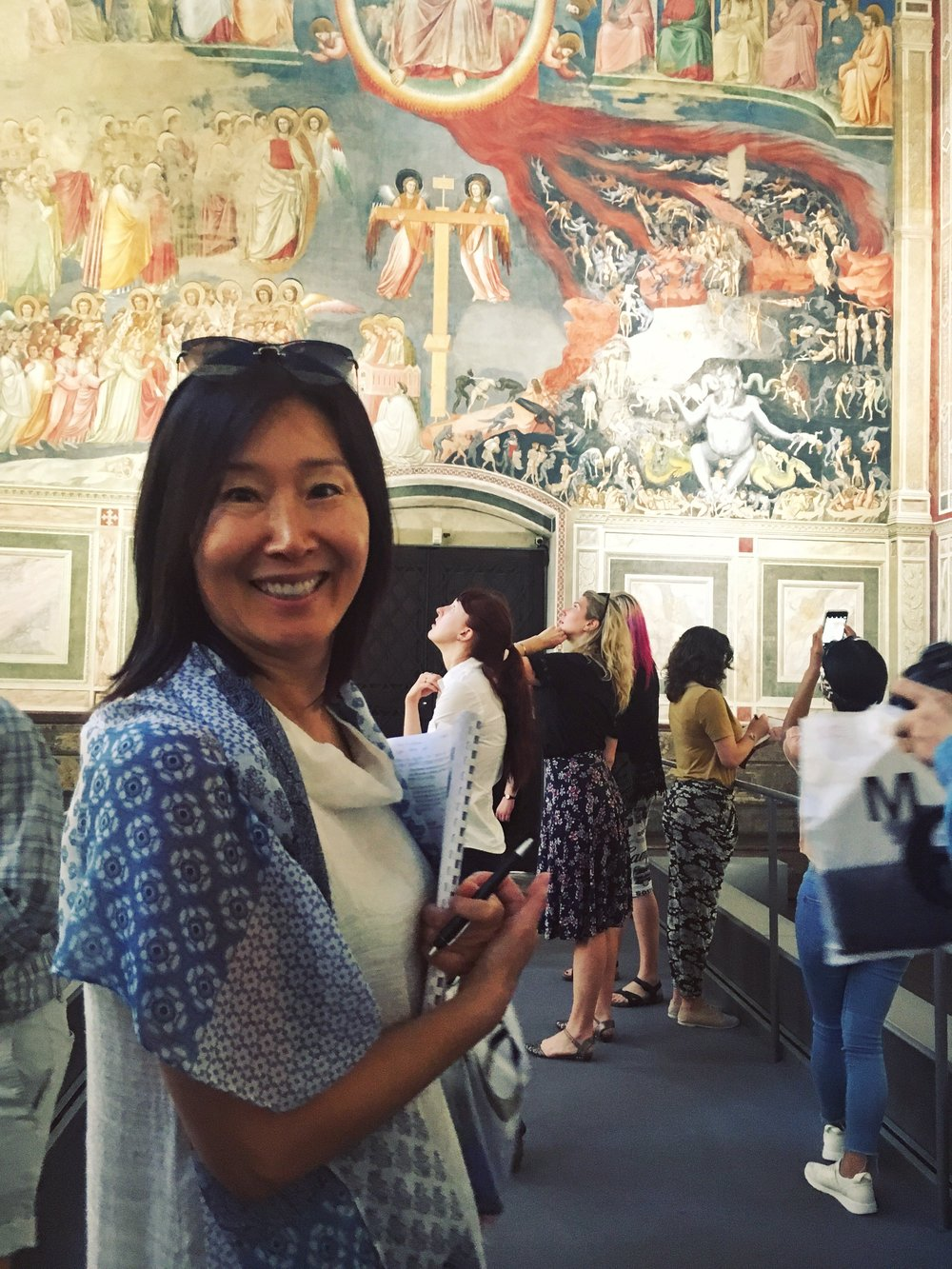 June Kim, undergraduate student of Painting, with Giotto's frescoes in the Scrovegni Chapel in Padua