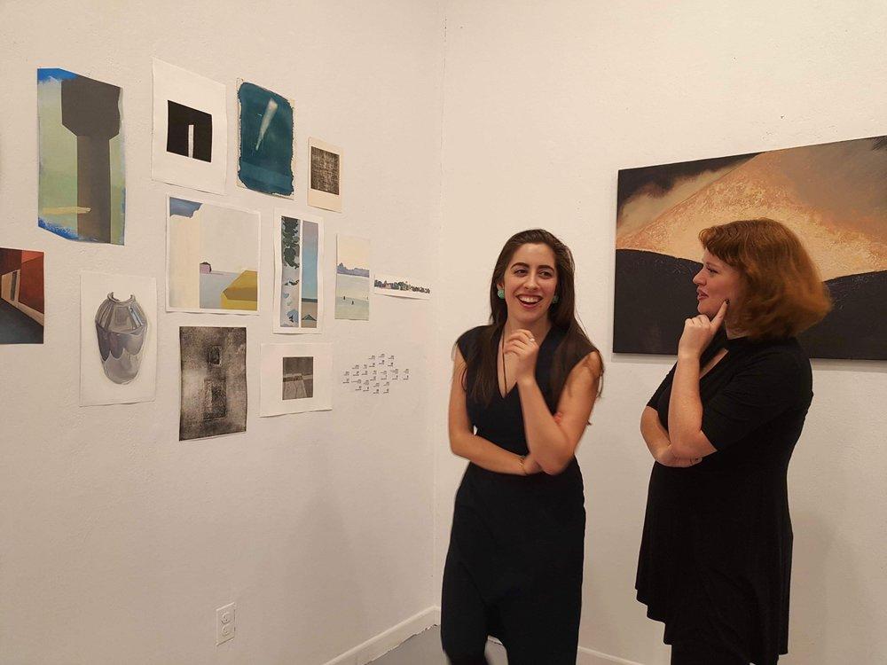 Graduate Assistant Safiye Senturk (MSLIS/MA Art History; PIV 2017) and Marietta Burdick (BA Art History; PIV 2017) admiring Xingze Li's work