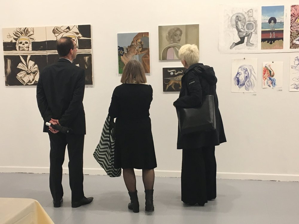 President Frances Bronet and her husband Jeff Paules looking at MFA student Jessica Niello's oil paintings with Pratt in Venice Director Diana Gisolfi