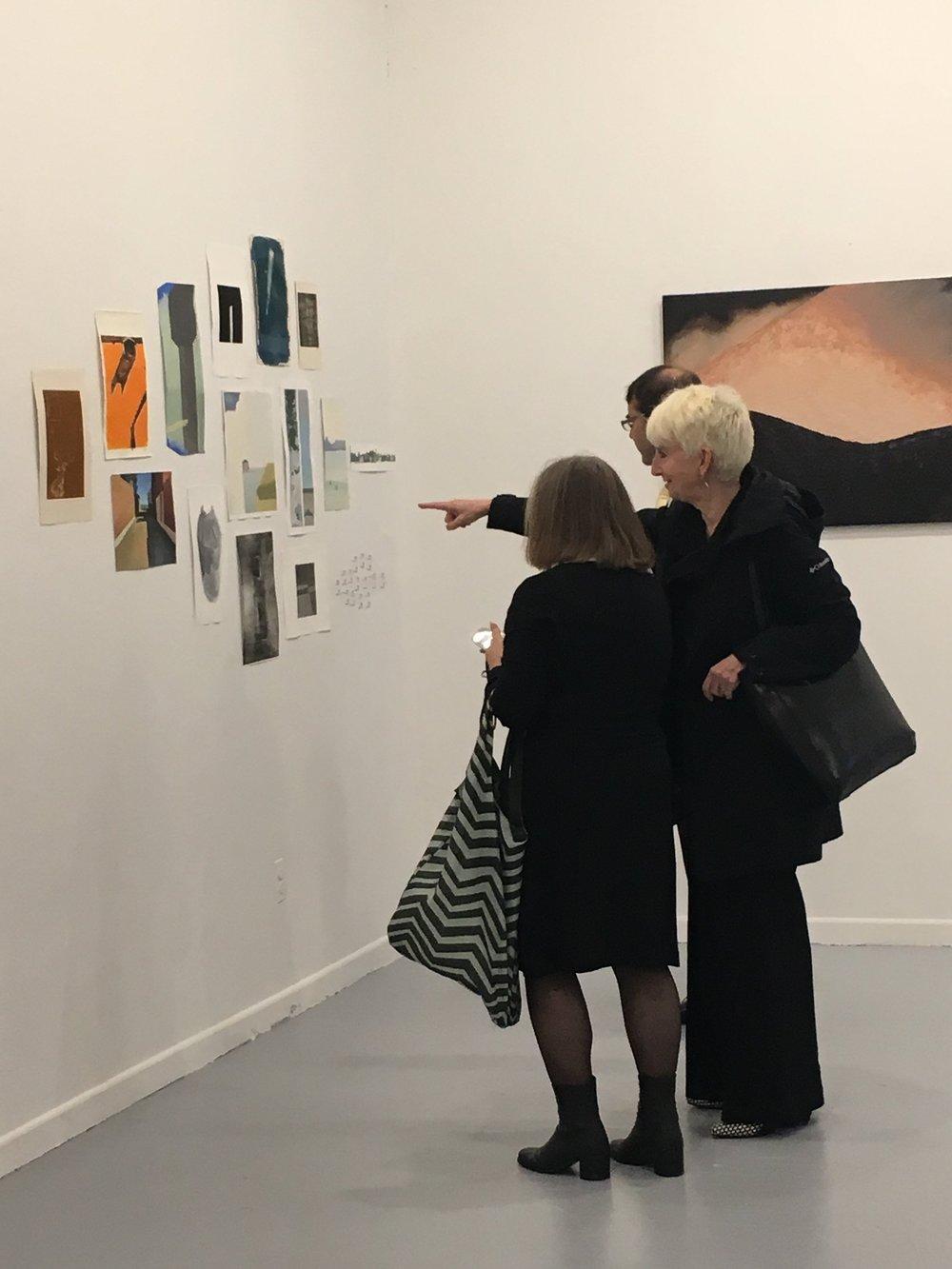 President Frances Bronet, husband Jeff Paules, and Pratt in Venice Director Diana Gisolfi admiring MFA student Xingze Li's work
