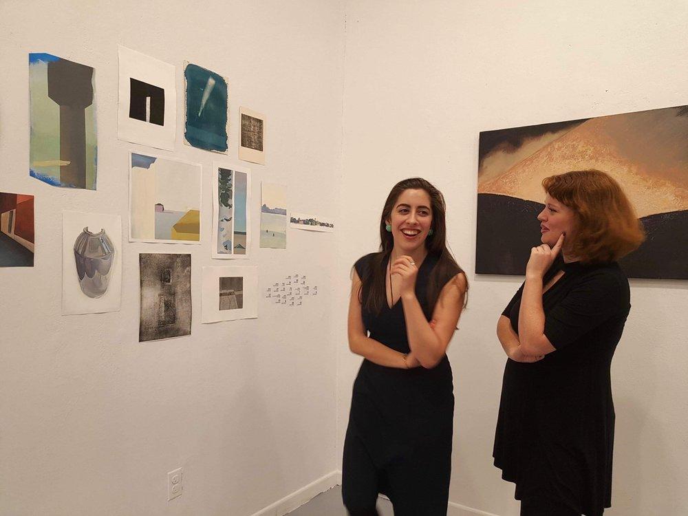 Graduate Assistant Safiye Senturk (MSLIS:MA Art History; PIV 2017) and Marietta Burdick (BA Art History; PIV 2017) admiring Xingze Li's work.jpg
