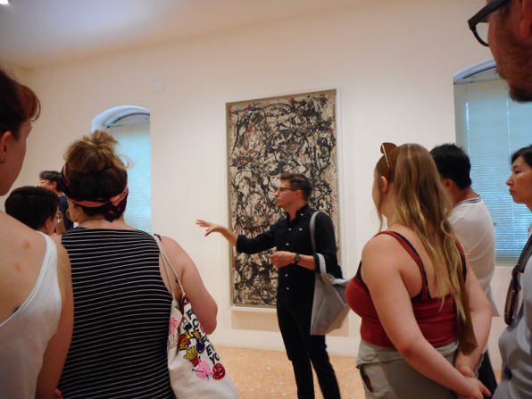 Andrew Kurczak (PiV '11 and '12, and Venice on-site assistant '16 and '17) leads the group through a tour of the Peggy Guggenheim Collection, July 2018