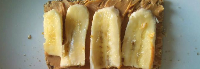Ryvita with peanut butter and thin slices of banana
