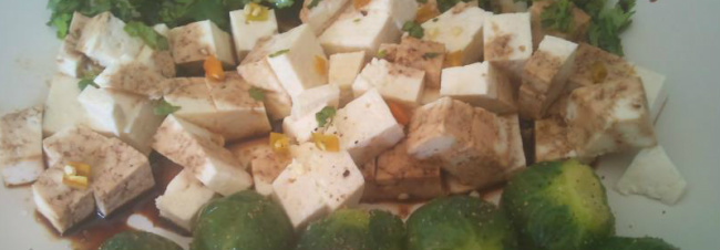 Tofu garnished with soy sauce, corainder and chilli, served with Brussels Sprouts