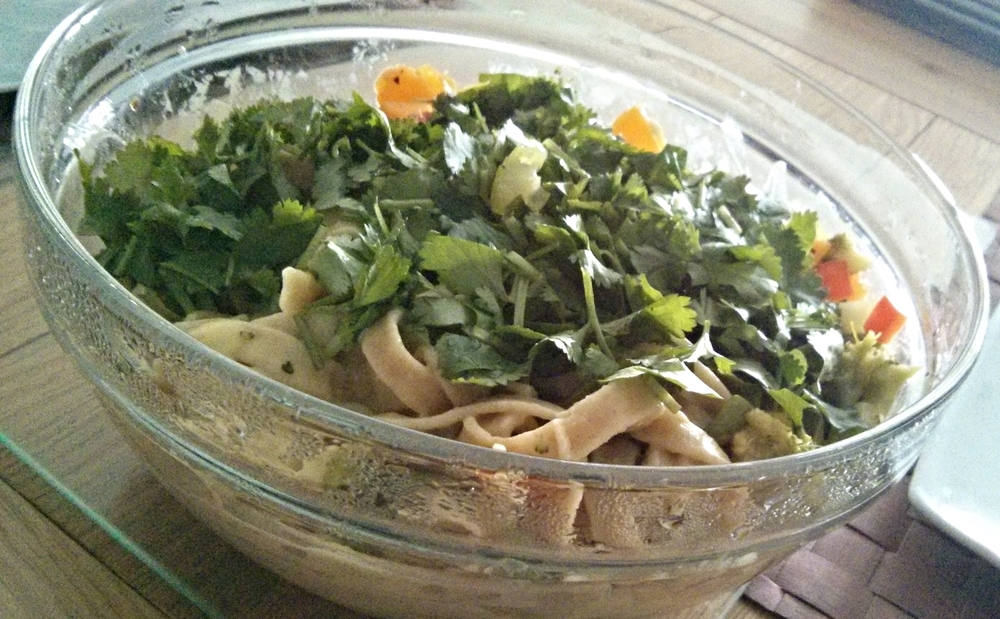 Tagliatelle with vegetables in a white sauce