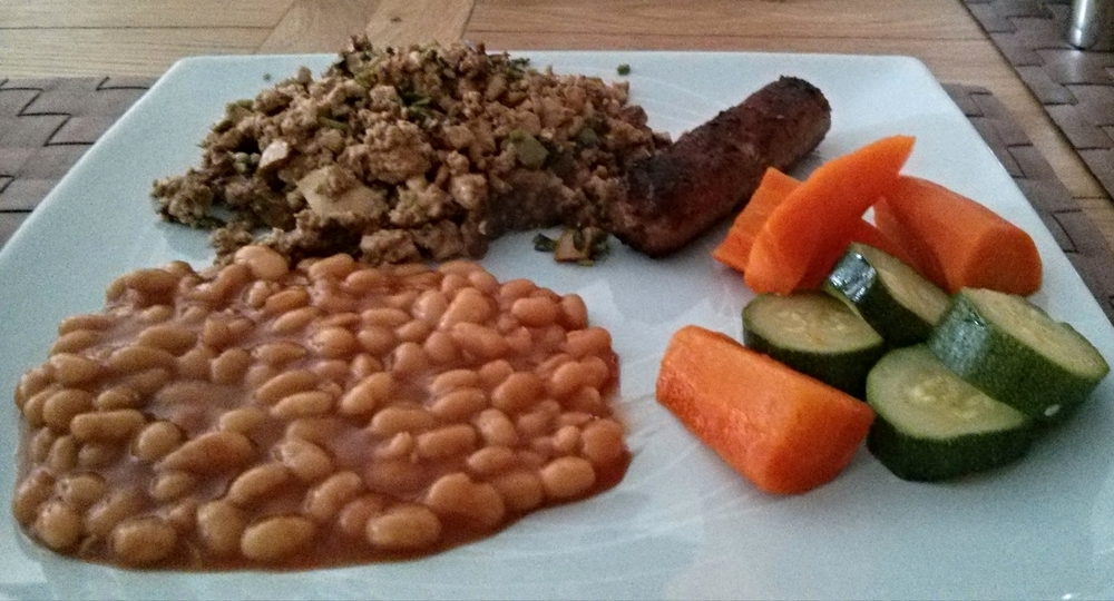 Scrambled tofu with vegetables, beans and sausages