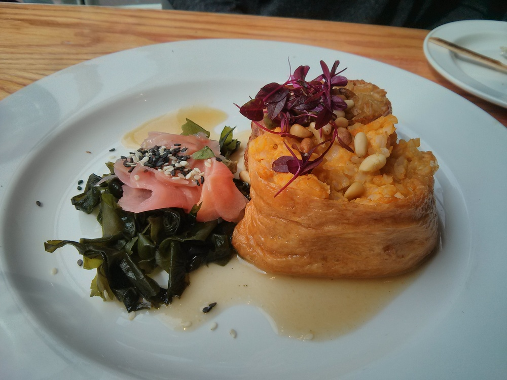 Duo of sweet tofu pockets first stuffed with shiitake rice and pine nuts, second with butternut squash, tofu and miso rice served with pickled   ginger, wakame and a sesame mirin dressing