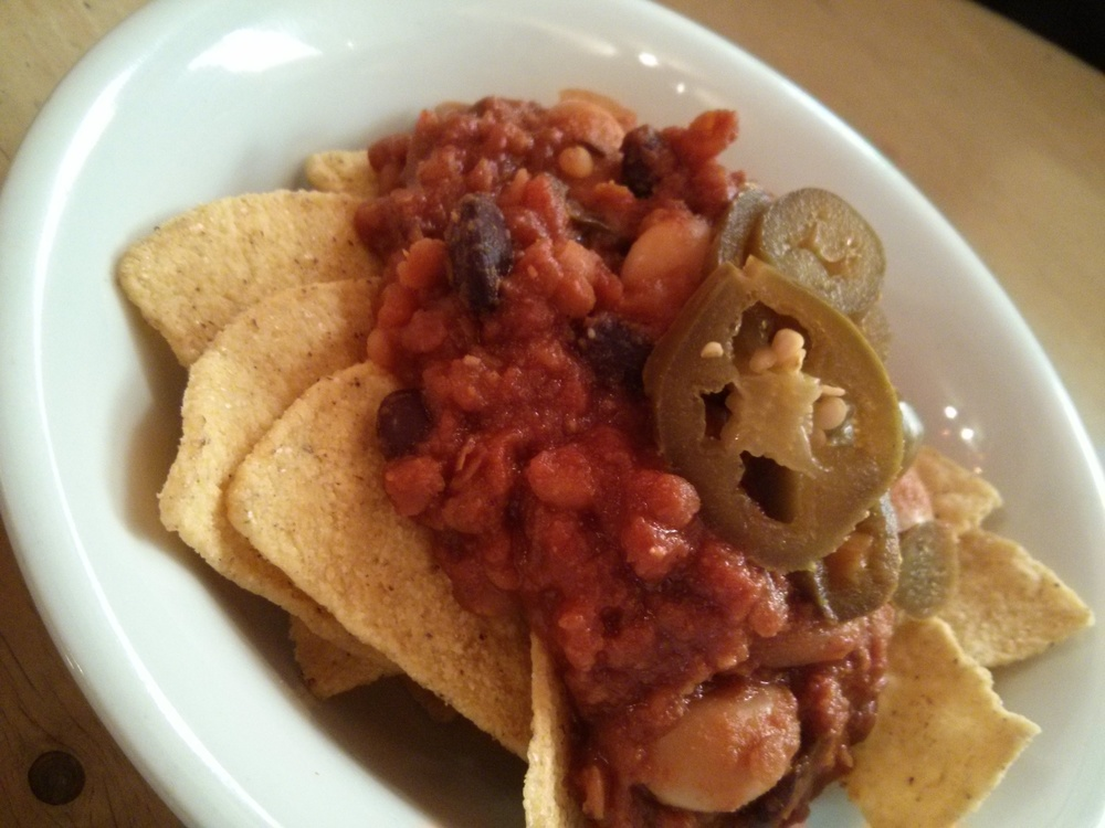 Kid size portion of nachos with meatless chilli
