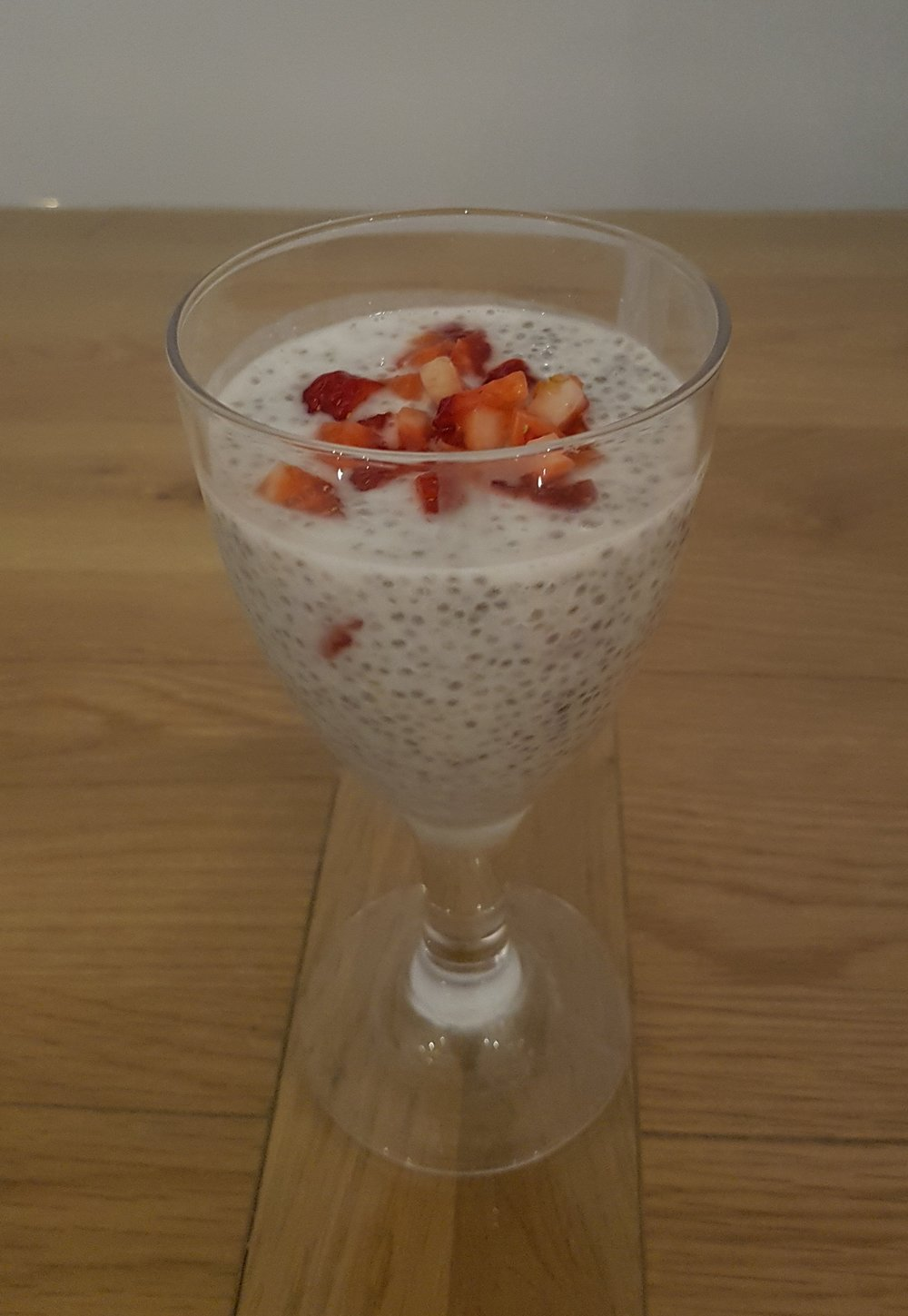 Chia Seed Pudding with chopped strawberries on top