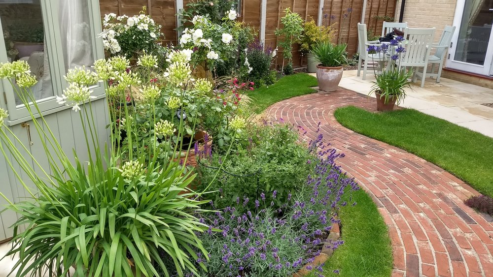 Karen No 10 curved path and border alongside summerhouse towards top patio July 2017.jpg