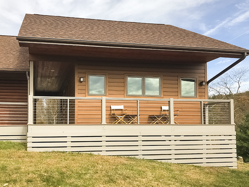 Photography Studio - Includes a breezeway and deck with cable rails and composite decking. The interior is furnished with a darkroom, custom built-in drying shelves, 1/2 bathroom and a loft.
