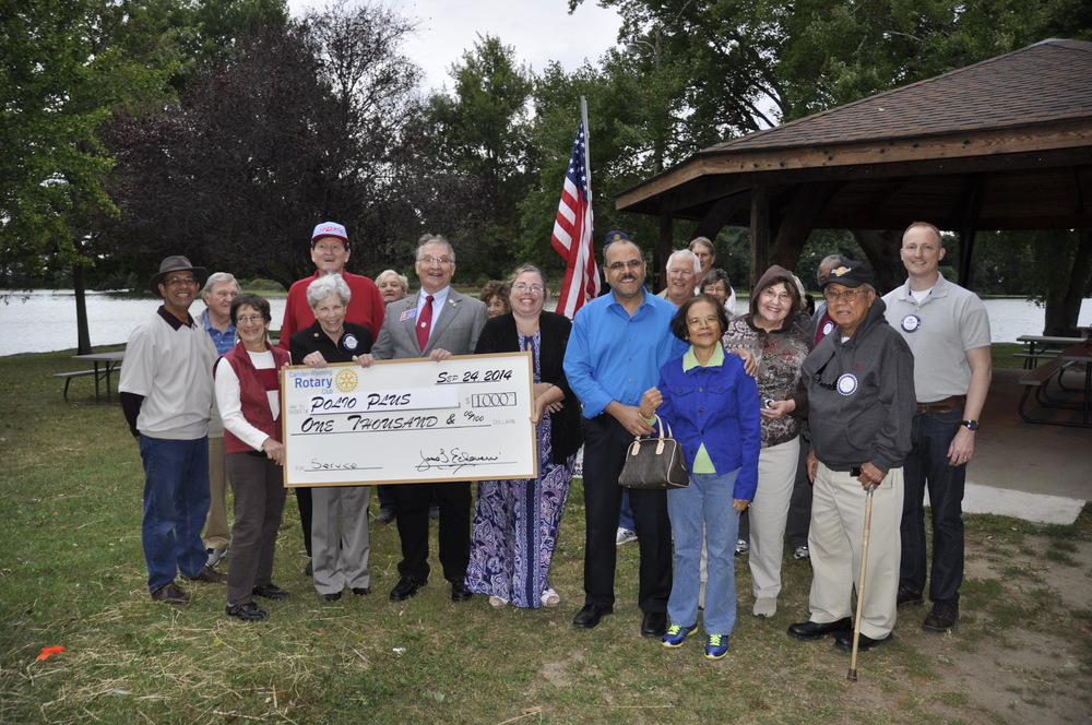 Mr. John Kotzun, Rotary District 7630 Assistant Governor (Area 30), stands with Rotary members and guests after receiving a $1,000 donation on behalf of The Rotary Foundation, PolioPlus..   Photo by Ron Kahn.