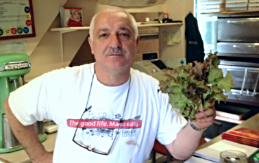 Papa Sam with first lettuce crop from his Seed Haven garden