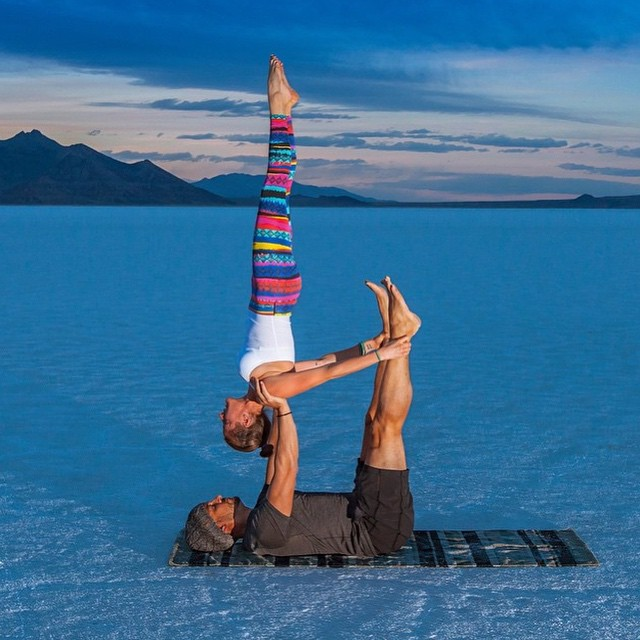 Repost from our amazing Co-Ambassadors @wildacroduo and @roxychristensen. Here they are in reverse candlestick out in the Bonneville Salt Flats. This place looks absolutely magical in this subtle lighting. 💕 #yoga #acroyoga #saltflats #wildacroduo #candlestick #partneryoga #outdoorwomen #outdooryogis #inspiredyogis #inversions #circomnavigate
