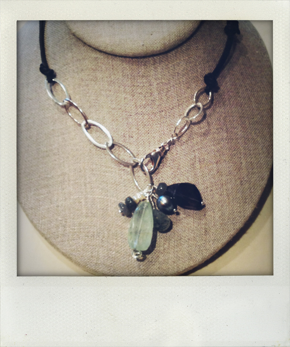 Mixed it up with metal and leather. Pendant is aquamarine, freshwater pearl, labordite.