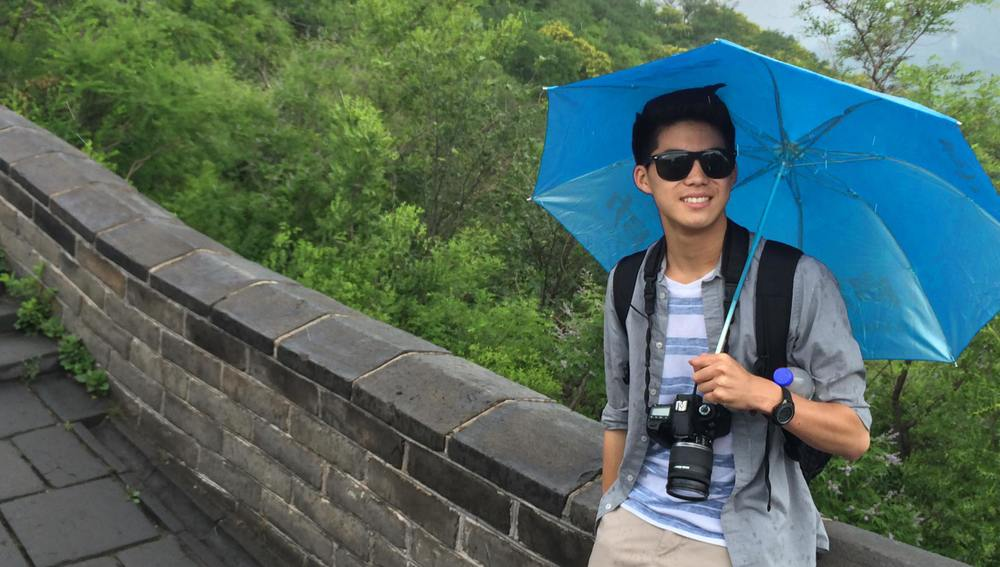 Kris takes a stroll on the Great Wall after a team meeting.