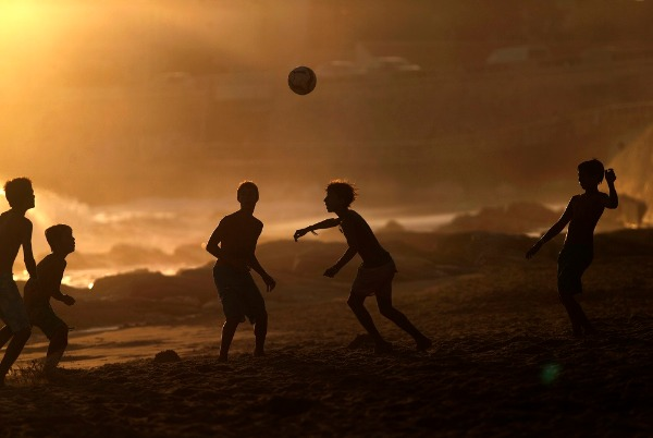 Youngsters play soccer as the sun sets at the Carcavelos beach in Cascais, near Lisbon, Tuesday, Sept. 2, 2014. The beach, a well-known surfing spot, is mostly frequented by locals from the Portuguese capital and also by tourists. Credit: AP Photo/Francisco Seco retweeted from Digg.