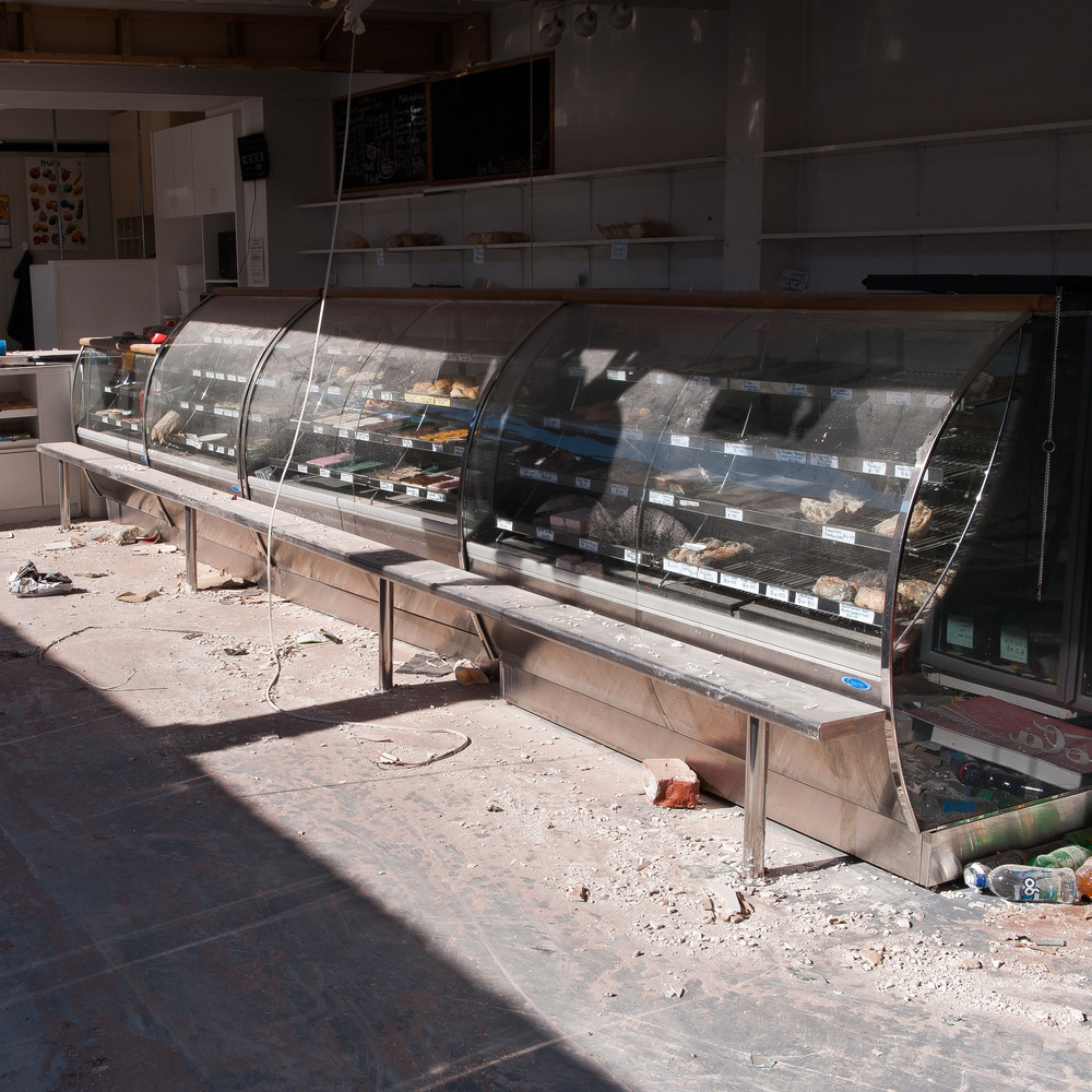 A Sydenham Bakery; one person was killed and another paralysed for life when a neighbouring building collapsed onto this store during the February 22nd earthquake. Three months after the event and food was still sitting in the cabinets as it was ready for sale on the day of the earthquake.