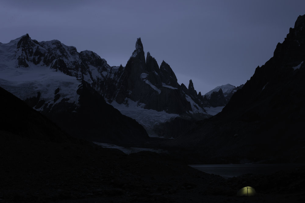 The sky goes dark over Cerro Torre and my previously incognito grey tent is gently illuminated.