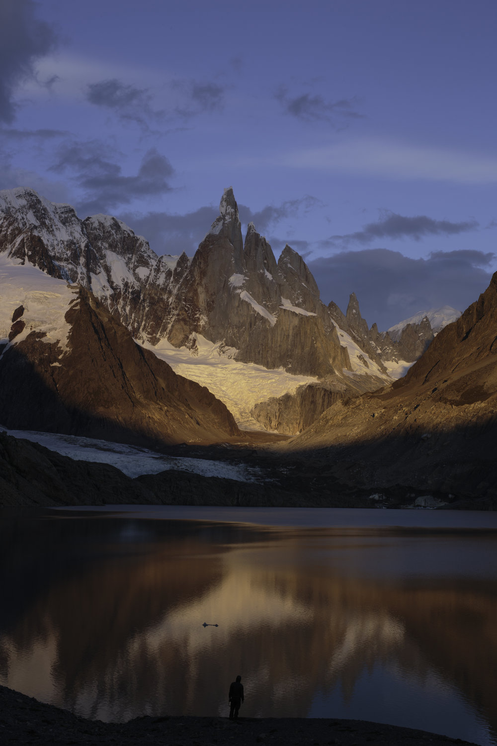 The wind rolls across Lago Torre towards an unknown early morning onlooker.