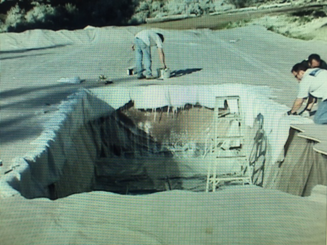 Build a fake frozen lake in July...fill pit with water...then sink a truck in it... CHECK!