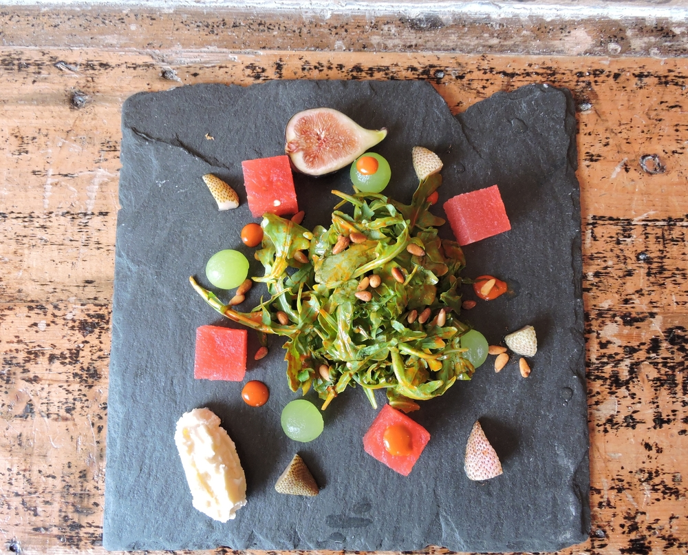 compressed melon salad - pickled strawberries, baby arugula, whipped feta, toasted pine nuts, dried chili vinaigrette