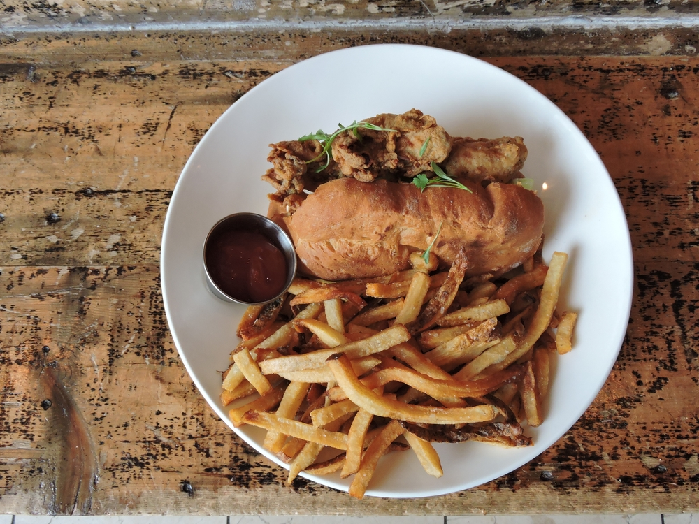 oyster po boy - shredded lettuce, pickles, old bay aioli, New England split roll, beef fat frites