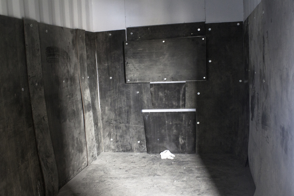 Inside of blast booth with rubber wall for sand blasting