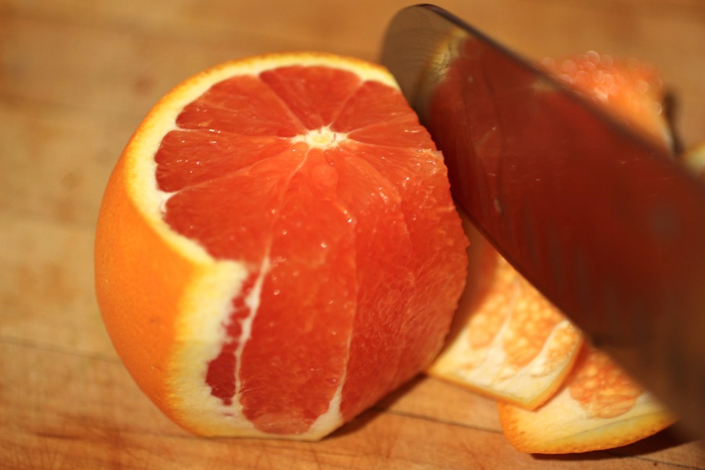 Cut peel off of citrus fruit.