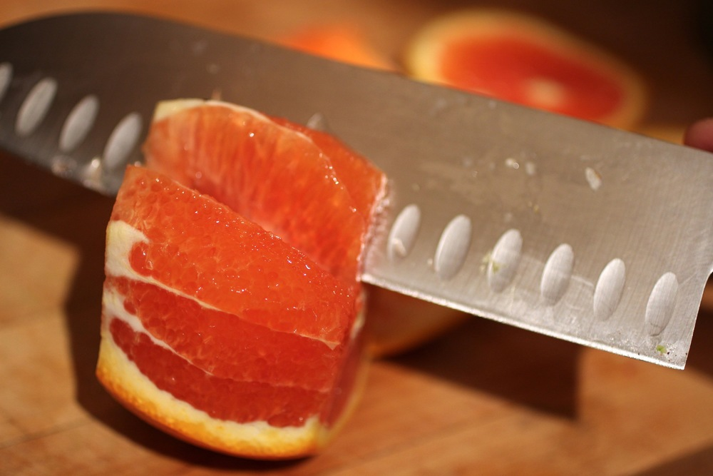 Cut into flesh to remove segments.