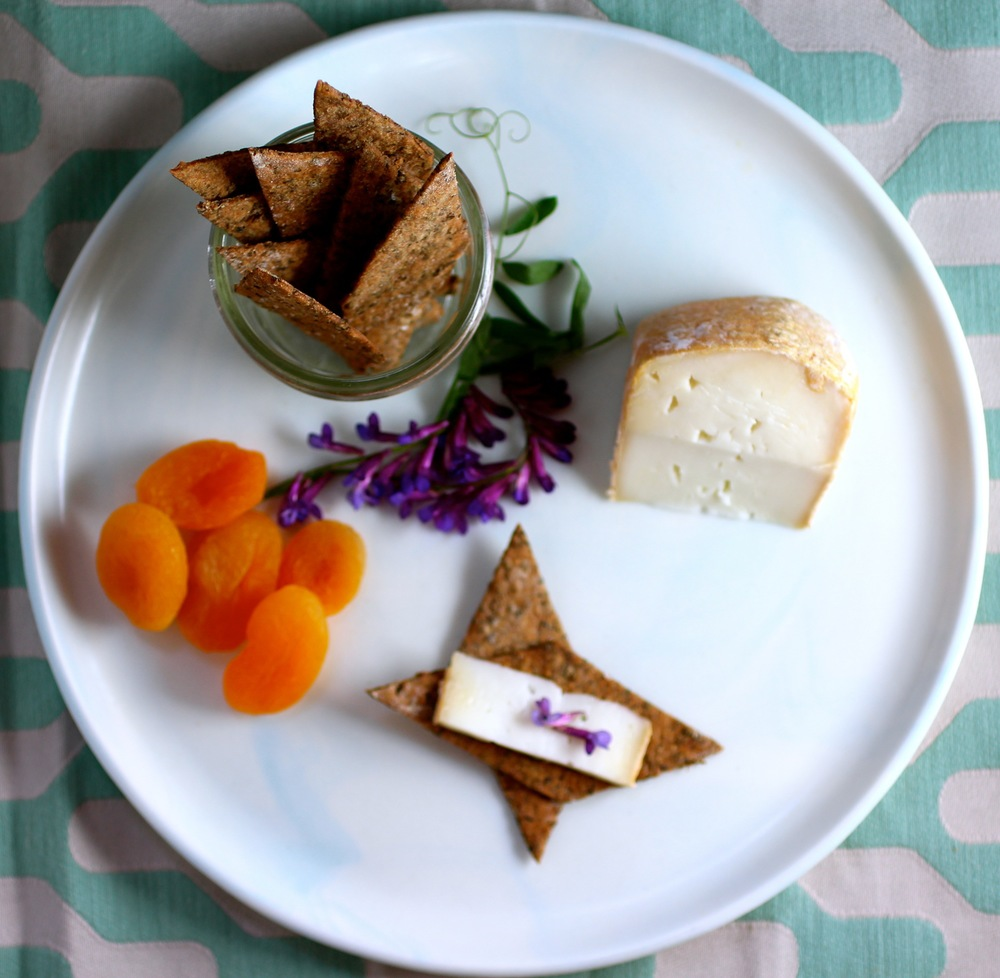 A beautiful cheeseplate is complete with  Rumex crisps .