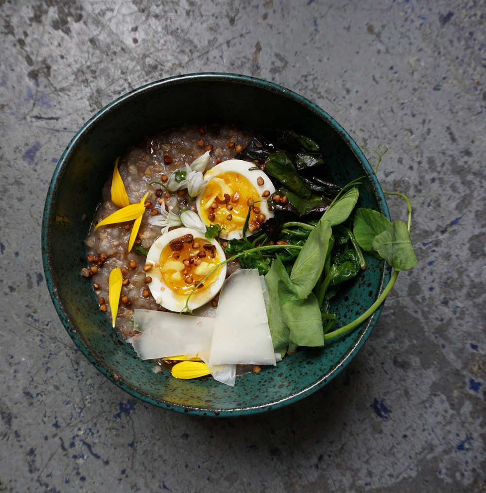 The buckwheat, greens, and goat gouda porridge with soft cooked egg. This time also with pea shoots and wild onion.