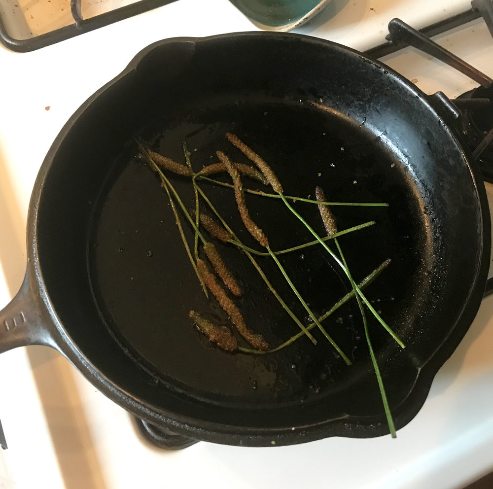 Sautéing seedpods in cast-iron. At this point, they have soaked up all of the butter/oil and if I need to cook them longer I would have to add more.