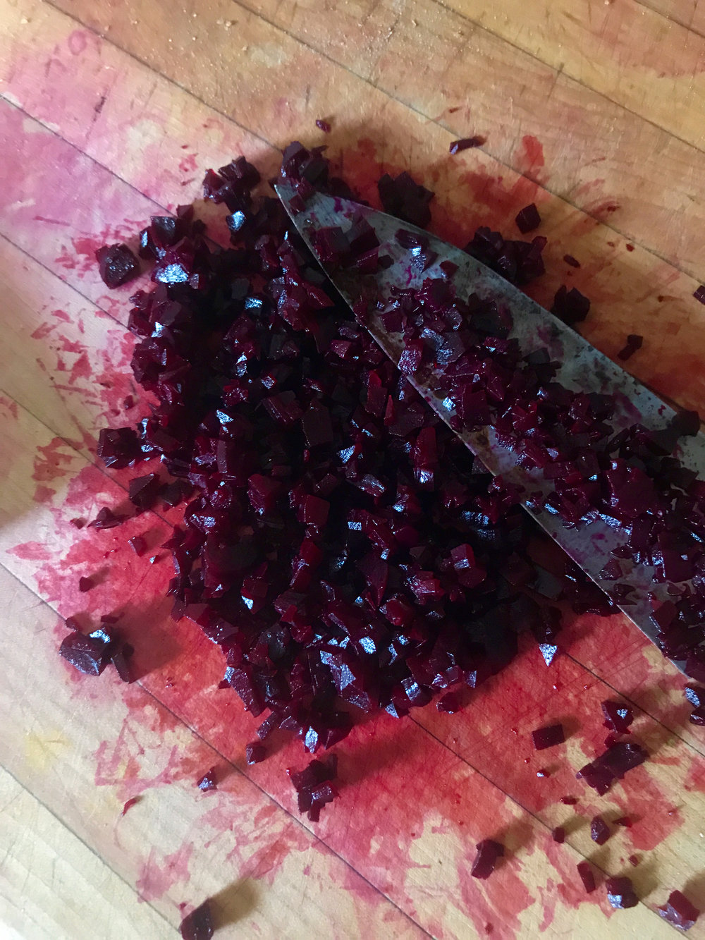 Finely mincing beets - it's not blood, it's beet juice! Be careful, it stains.