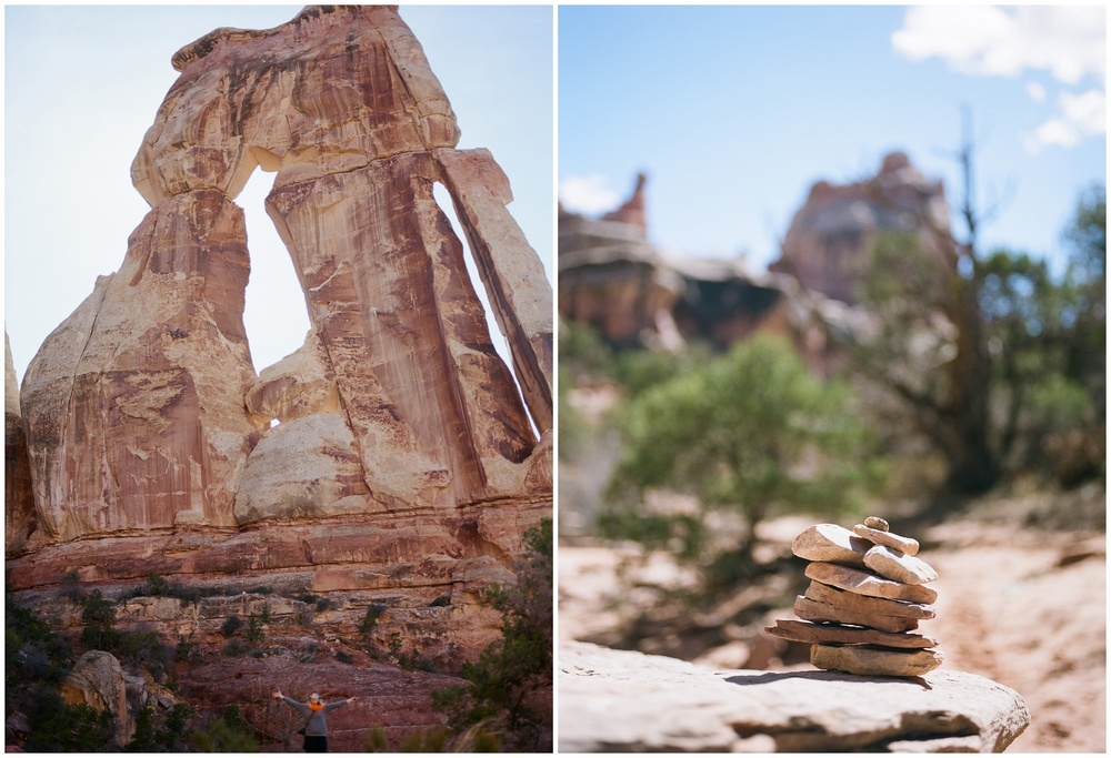 Sonja in front of Druid Arch, Canyonlands National Park. A rock cairn  marks the trail in Elephant Canyon. Film photography by Sonja and Max Salzburg of Sonja K Photography.